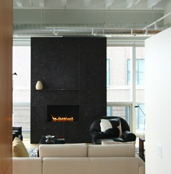 Freestanding Monochromatic Fireplace Against Simple
