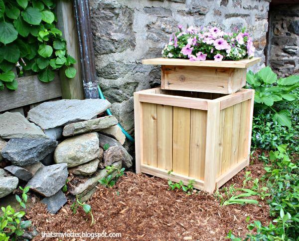 Hide outdoor eyesores with this hide away hose bin & planter