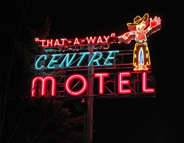 """Neon sign of """"That-A-Way"""" Center Motel, Elko, NV."""