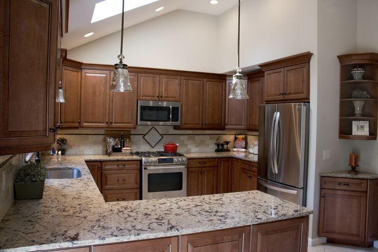 A kitchen remodel in Wading River, New York was designed with Urban Effect Cabinetry's Legacy door style in Maple finished in a beautiful brown cabinet color called Caramel with Midnight glaze. Artistic Cabinetry, LLC, is an Urban Effects Cabinetry dealer in Smithtown, New York.