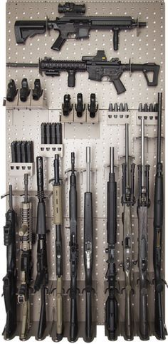 "This rack system uses three of the 24"" x 36"" wall panels and will hold 2 rifles horizontally, 10 rifles vertically, 6 hand guns, approx 4 hand gun mags and approx 8 AR (223) or AK mags Product 1032   gssdoors.com"