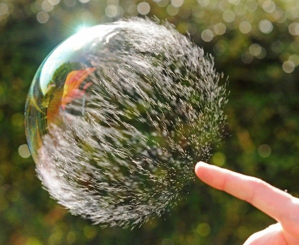 Awesome capture: the moment a bubble starts to burst. Think I'm going to have to try this one.