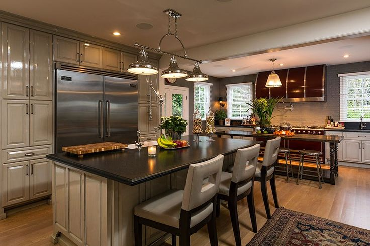 Jeremy Renner-The stately eat-in kitchen features a Viking refrigerator and a La Cornue range.