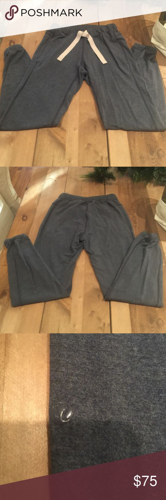 ADORABLE AND RARE Lululemon Lounge Pants size 4!! Lululemon comfy pants great for to and from the gym or yoga or just relaxing at home. I wore these once. Blueish grey color with beige waist tie. Elastic waistband and at ankles. lululemon athletica Pants Track Pants & Joggers