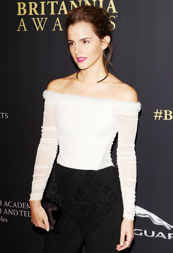 Emma Watson accents a white-off-the-shoulder top with a gold Jennifer Fisher choker necklace