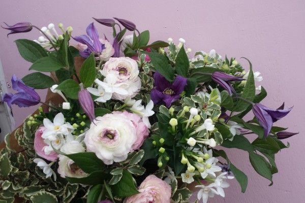 Pinks and purples. Ranuculus, Clematis, Bouvardia and Pittosporum