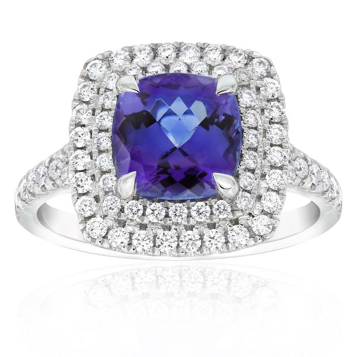 Rare and beautiful. Kilimanjaro tanzanite and diamond dress ring. This cushion cut tanzanite is a deep bluish-purple colour and surrounded by a double halo of diamonds. Crafted in 18ct white gold. This ring will be customised to perfectly fit your finger, which may take up to 6 weeks