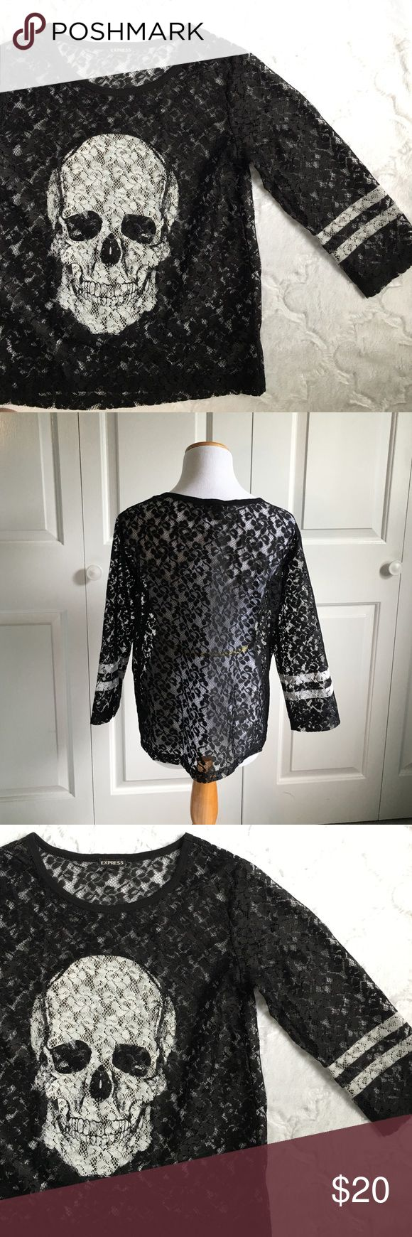 Black Lace Skull Top Black lace top with skull detail. Boxy style. Sheer. 100% polyester. Excellent condition, worn twice. 3/4 sleeves. Size small but could easily fit a medium. Express Tops