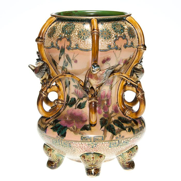 Early Zslonay Oriental-style urn sculpted with a flock of finches settled on bamboo branches.