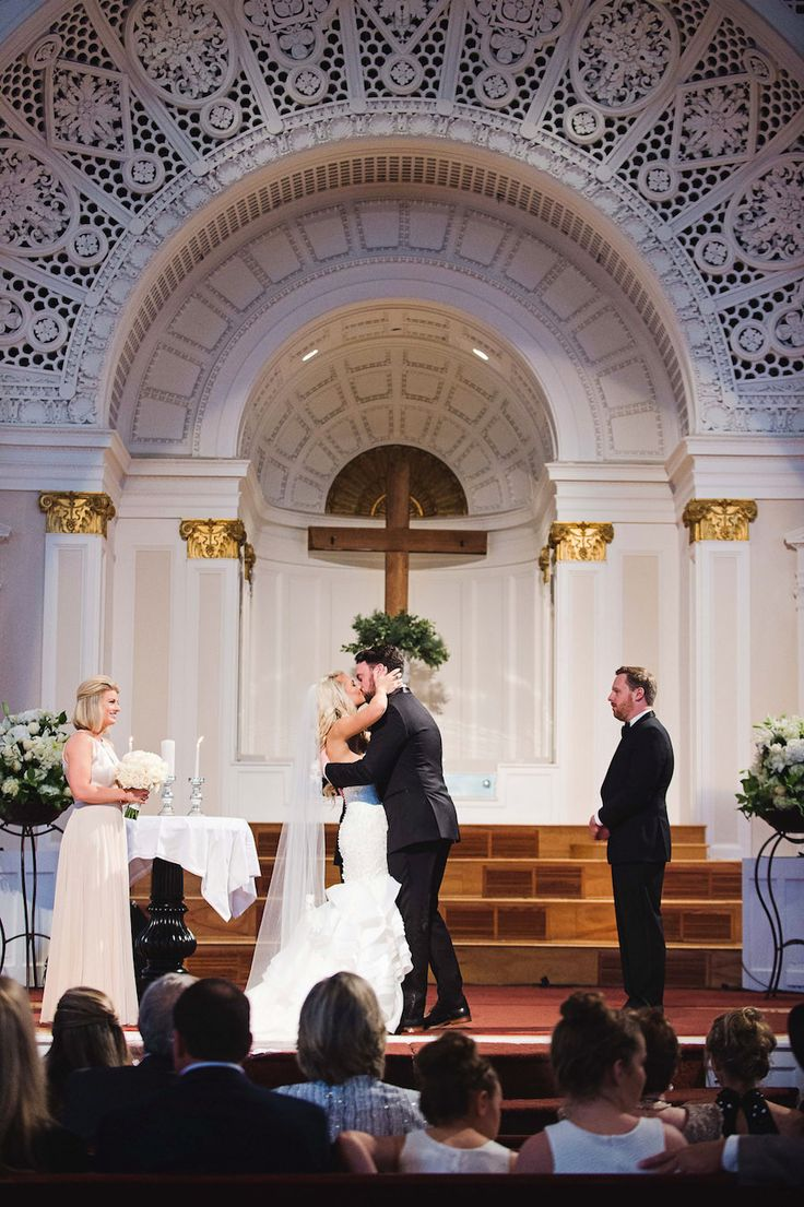bride and groom tampa wedding ceremony kiss at first baptist