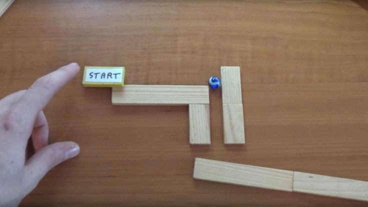 Rolling marbles and super-magnets make an irresistible Rube Goldberg track (VIDEO).