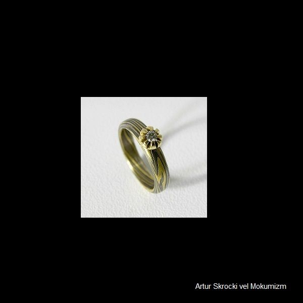 Ring Au, Pd, Ag + 0,21ct