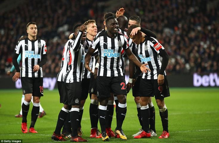 Christian Atsu celebrates with his Newcastle United team-mates after scoring their third goal against West Ham