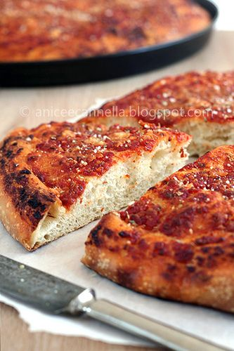 typical Italian focaccia of Basilicata with tomato, oregano and pecorino. Made with natural yeast.