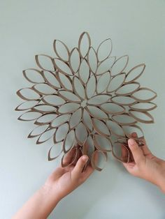 Flower:  If you'd like to make your own flower, all you need is toilet paper rolls (or paper towel rolls) and craft glue.  Flatten the rolls, cut into bands (a toilet paper roll should give you about four circles).   Pop them out a bit so that you have a flower petal shape, and glue together on a flat surface, in any pattern you desire!