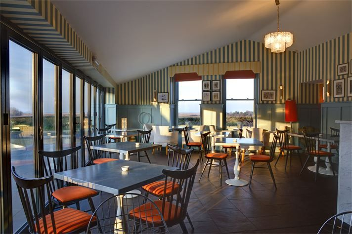 Titchwell Manor Hotel, Norfolk. Russen & Turner were Lead Designers & Contract Administrators for a new bar and restaurant extension to Titchwell Manor Hotel.  The resulting extension provided larger, more impressive restaurant accommodation to serve this award winning boutique hotel.