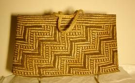 This kete is one of a series of kete and whariki that were presented to Mr and Mrs G McCurrach by the local people of Te Kaha in recognition..Mr McCurrach was the first policeman based at Te Kaha and resided there for over 10 years, completing his term in 1951.Catalogue description: The harakeke strips have been dyed a blackish colour. The dominant pattern is poutama. Attached just inside the rim are two handles plaited in a five-ply muka whiri.