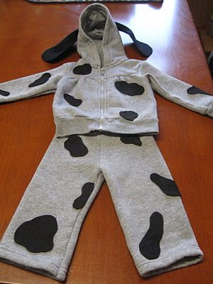 A Handmade Halloween Costume puppy costume with sweat suit. I would make the spots smaller, use a white sweat suit, and put pink fabric under the ears.