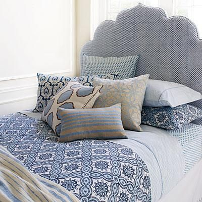 Exotic and rich prints on sheets, quilts, and pillows are a hallmark of John Robshaw's line. | Coastalliving.com