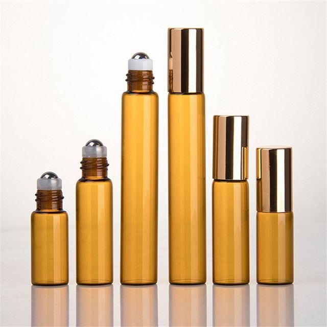 50pcs Lot 1ml 2ml 3ml 5ml 10ml Amber Roll On Roller Bottle For Essential Oils Refillable Perfume Bottle Deodorant Containers Review With Images Deodorant Containers Refillable Perfume Bottle Refillable Bottles