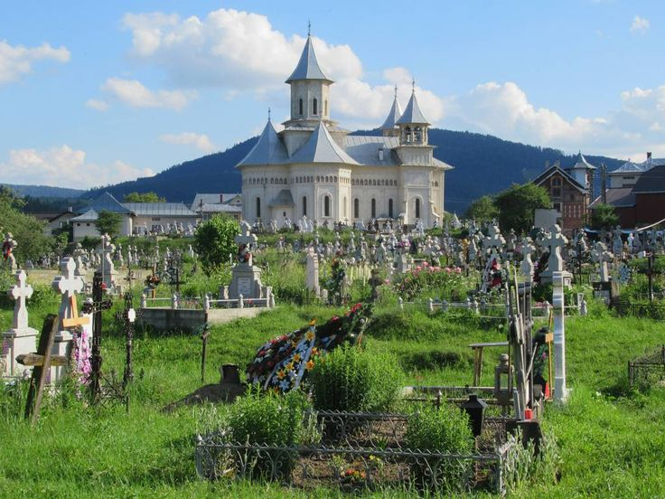 A large cemetery surrounds Ascension of God Church in Vama, Romania.
