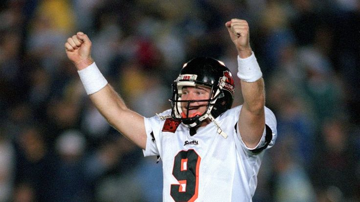 Smith will seek to resurrect the program that he led to 11 wins and a No. 4 ranking in 2000 as a walk-on quarterback.