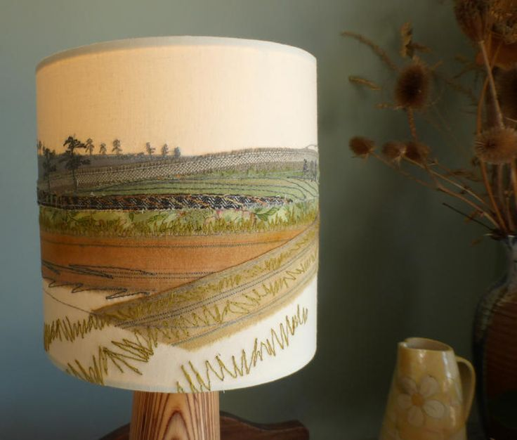 Please note, this lampshade will be made to order. There is one currently on display and available to buy at Gallery at 12, Eccleshall, Staffordshire.Inspired by the great British countryside and its wonderful colours, this lampshade was made using appliqué, free-motion embroidery and hand-dyed fabrics. It produces a lovely glow when illuminated.This item is handmade and therefore one-of-a-kind. Please just 'add to bag' if you would like to commission your own. Please note that this w...