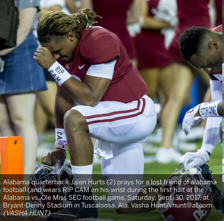 Alabama quarterback Jalen Hurts (2) prays for a lost friend of alabama football (and wears RIP CAM on his wrist during the first half of the Alabama vs. Ole Miss SEC football game, Saturday, Sept. 30, 2017, at Bryant-Denny Stadium in Tuscaloosa, Ala. Vasha Hunt/vhunt@al.com (VASHA HUNT) Alabama 66 Ole Miss 3 #Alabama #RollTide #Bama #BuiltByBama #RTR #CrimsonTide #RammerJammer