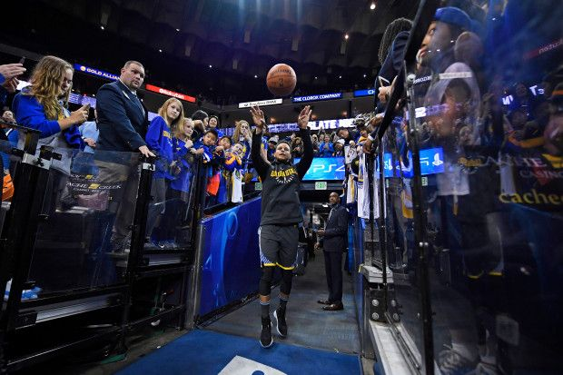 Golden State Warriors' Stephen Curry (30) throws his ritual basket shot from the tunnel before the start of their NBA game at the Oracle Arena in Oakland, Calif., on Saturday, Dec. 30, 2017. Curry returns to the floor tonight after sustaining an ankle injury on Dec. 4th. (Jose Carlos Fajardo/Bay Area News Group)