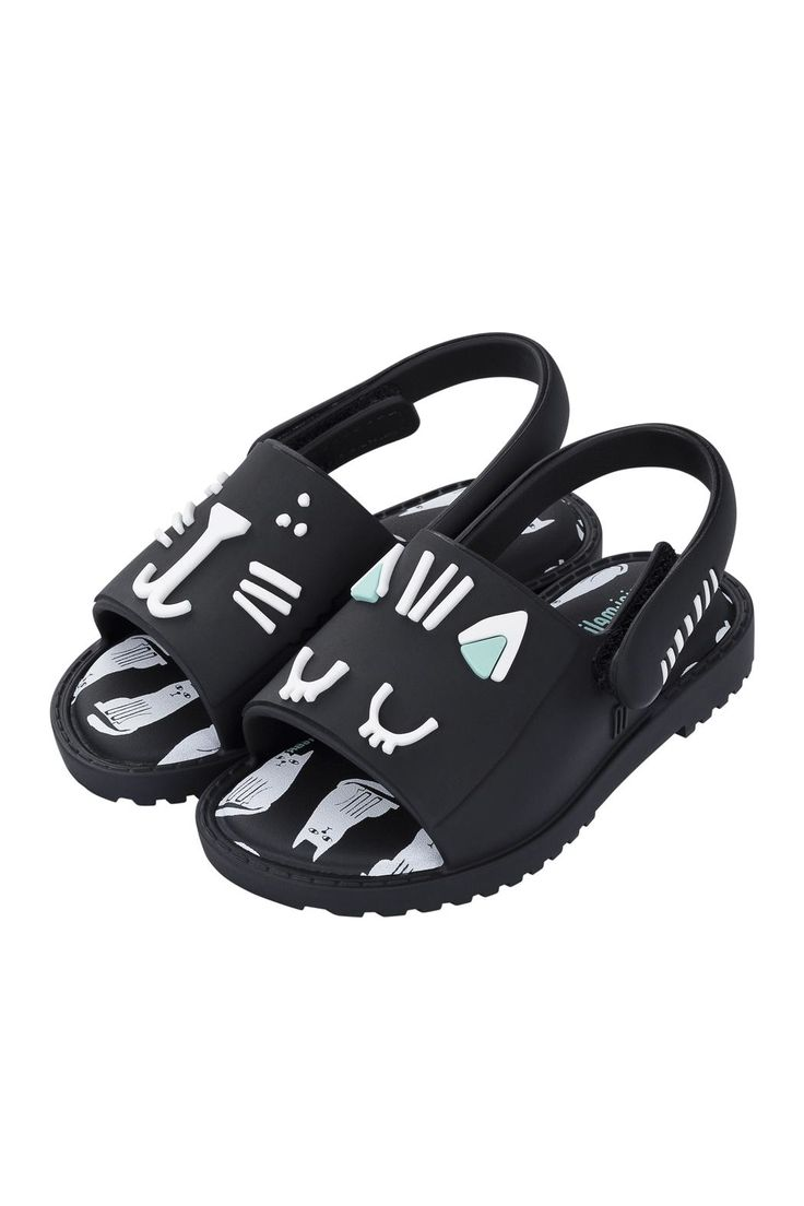 These cute and stylish cat themed jellies take your little fashionista from the beach to the streets. Paired with a swimsuit, dress or shorts & a tee - Mini Melissa sandals are all the craze! These sandals slide on and have a strap around the back that closes on the side.   Kitty Sandal by Mini Melissa. Girls - Shoes New York City
