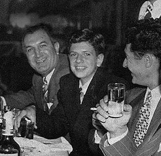 Joseph Bonanno, his son Bill Bonanno, and capo Gaspar DiGregorio. Bill Bonanno would marry Joe Prafaci's niece Rosalie in 1956, cementing a close bond between the leadership of the two Mafia families. Bill and Rosalie's wedding inspired the opening scenes in The Godfather.