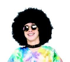 the 'fro and the tie-dyed tee--all that is missing is the Peace sign