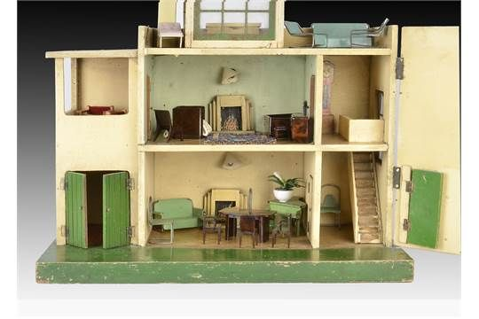 A Tri-ang Ultra Modern dolls' house DH/50 1939, painted cream, green wooden front door and garage