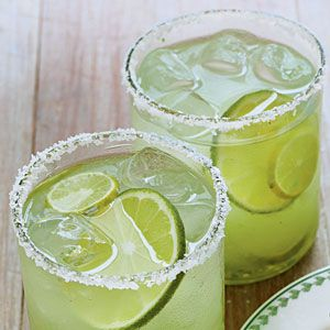 Pepper Jelly Margaritas Recipe --//   1 cup tequila  / 1 cup fresh lime juice  / 1/2 cup orange liqueur  / 1/3 cup powdered sugar  / 1/4 cup green pepper jelly  / Garnish: lime slices  // Stir together first 5 ingredients in a large pitcher, stirring until sugar and pepper jelly are dissolved. Shake desired amount with ice. Strain into chilled glasses with salted rims. Serve immediately.