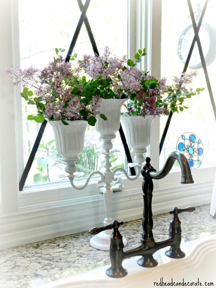 DIY Candelabra Vase/Planter: She made it from old ceiling fan shades & an old candelabra. She has also planted basil in it for year round fresh herbs.