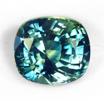 "A very compelling, unheated, ""fancy"" sapphire hailing from Montana, weighting 1.58 cts., medium, vivid, bi-color, yellow & green, blending however, very well in an intense ""teal"", greenish-blue color, masterly executed, ""antique"" cushion, mixed cut, and measuring 6.38x5.64x4.63mm, eye flawless, VVS1 from the Rock Creek deposit, Philipsburg, Montana."