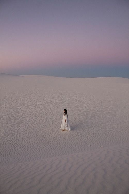 With the sand beneath her feet and her heart facing the sun, her worries went in with the tide