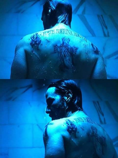 #JohnWick/JohnWickChapter2  John, I wonder how long it took to make those tattoos real because I'm pretty sure Keanu Reeves doesn't have any but maybe he does..who knows.