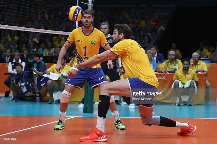 Lucas Saatkamp #16 and Bruno Rezende of Brazil in action during the men's qualifying volleyball match between Brazil and United States on Day 6 of the Rio 2016 Olympic Games at the Maracanazinho on August 11, 2016 in Rio de Janeiro, Brazil.