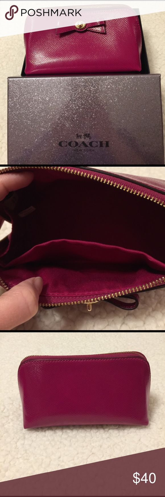 🎉 FREE SHIPPING (Offer $7 less) 🎉Coach bag NWT Coach glossy cranberry zip up bag, box included. For corralling make up or to hold all those things that fall to the bottom of your purse - lipstick, bobby pins, etc! Has 3 tiny white dots on it - so small I can't get them to show up in a pic. Smoke & pet free home, I almost always ship same or next day. Coach Bags Cosmetic Bags & Cases