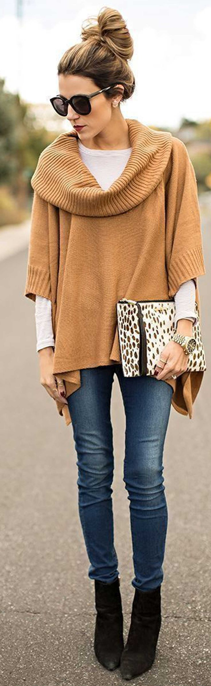 brown poncho with shite long sleeve, dark jeans, printed clutch, messy bun. #lotd #clothing #outfit