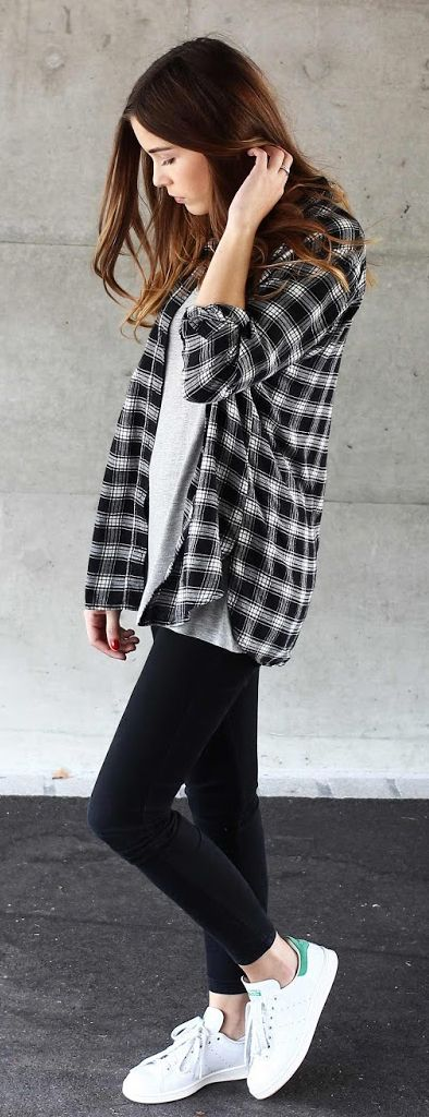 Lena Herrmann is wearing a black plaid H&M shirt with Dr. Denim skinny jeans and white Stan Smith sneakers