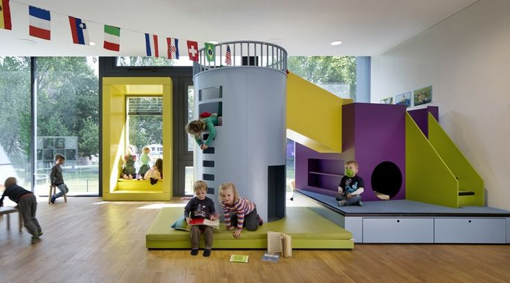 Kadawittfeldarchitektur have designed this day care in Hamburg, Germany. The exterior visual language is carried through to the interior furniture / play modules