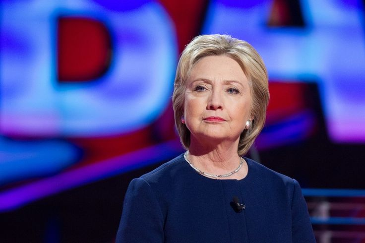 Democratic presidential candidate Hillary Clinton awaits the start of the Democratic Debate in Flint, Michigan, March 6, 2016. / AFP / Geoff Robins        (Photo credit should read GEOFF ROBINS/AFP/Getty Images)