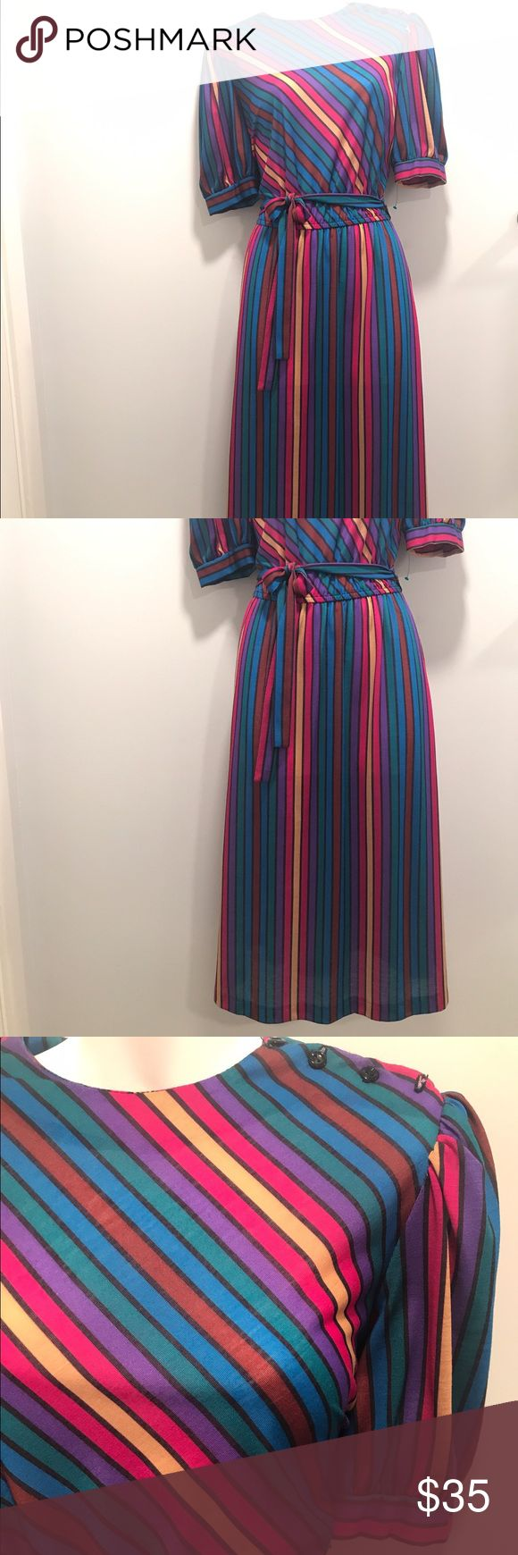 Retro multi color dress- size 12 This groovy dress is the perfect rainbow piece to your wardrobe. All original buttons are still attached along with the matching belt. Truly timeless. Get it before it's gone! Dresses Midi