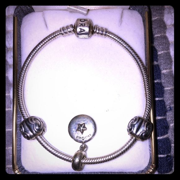 PANDORA BRACELET NEW CONDITION this bracelet has 2 heart charms & a pig (my favorite animal) charm- sterling silver- the pig charm can be removed at any Pandora location or Jewlery location  Pandora Jewelry Bracelets