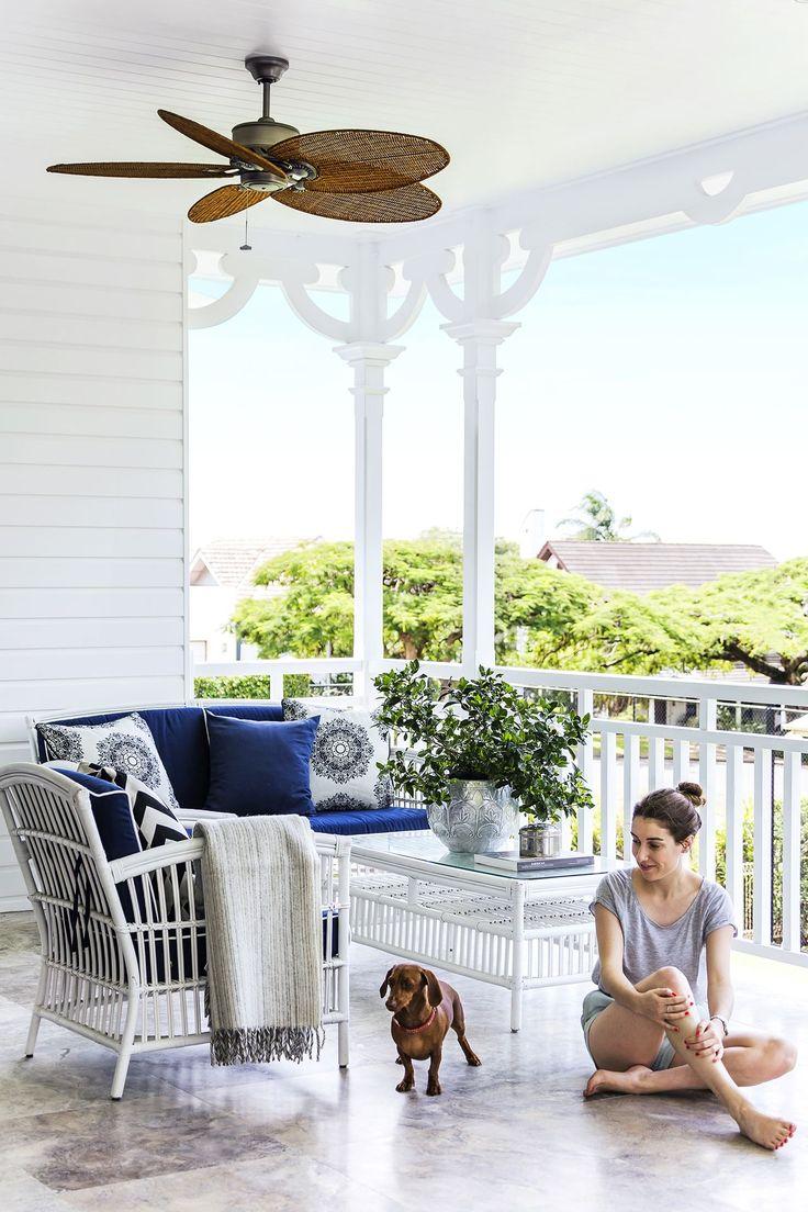 Verandah/balcony: travertine pavers, white timber balustrade, white wicker outdoor furniture, ceiling fan