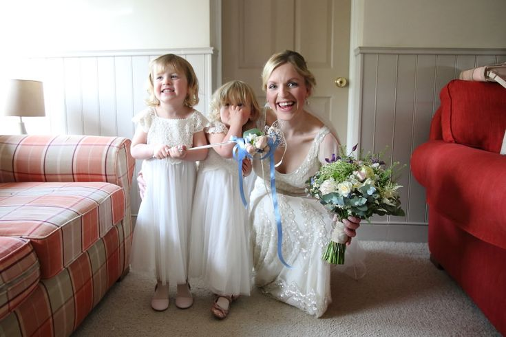 natural non-posed documentary wedding photography, bride and her daughters at home before the ceremony
