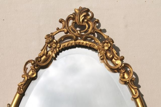 antique vintage beveled glass mirror w/ ornate old gold metal oval frame
