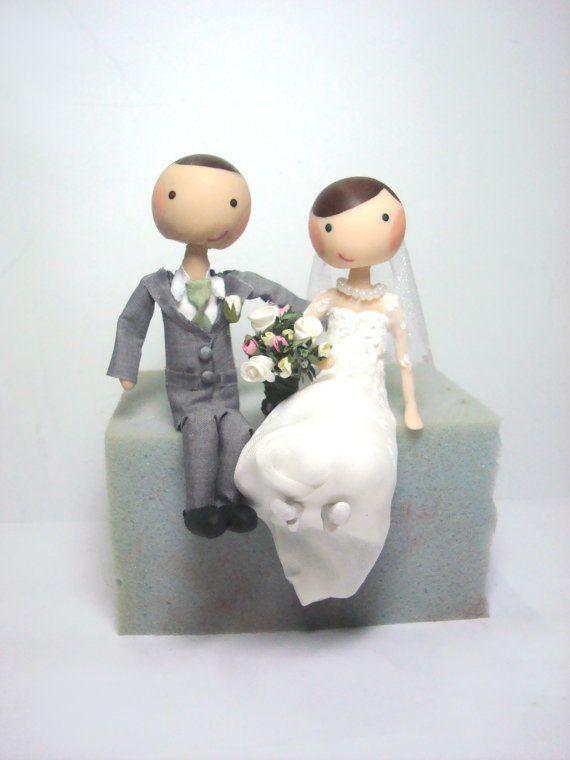 custom sitting edge of wedding cake toppers by lovelybertie